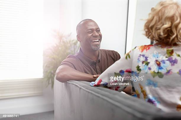 Interracial mature couple having a friendly chat - Indoors