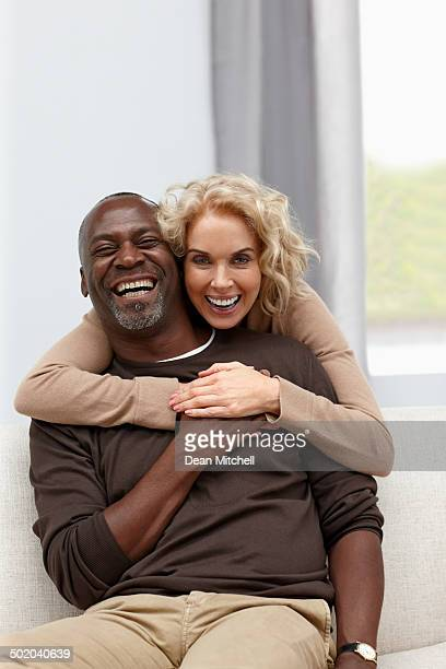 Interracial mature couple looking happy together