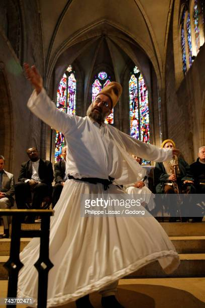Inter-religious meeting in Saint-Spire cathedral, Corbeille-Essonnes. Whirling dervish. France.