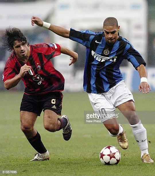Inter's Adriano goes past AC Milan's Ivan Gennaro Gattuso during the Italian Serie A match between AC Milan and Inter Milan at the Guiseppe Meazza...