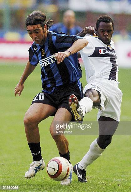 Inter's Alvaro Recoba fends off Parma's Fabio Simplicio during the Serie A match between Inter Milan and Parma at the Guiseppe Meazza San Siro...