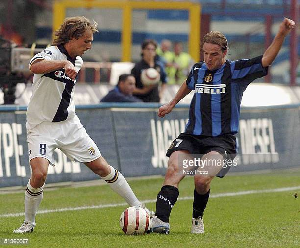 Inter's Andy van der Meyde fends off Parma's Alessandro Budel during the Serie A match between Inter Milan and Parma at the Guiseppe Meazza San Siro...