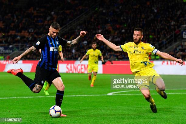 Inter's Argentinian forward Mauro Icardi vies with Chievo's Slovenian defender Bostjan Cesar during the Italian Serie A fotball match between Inter...
