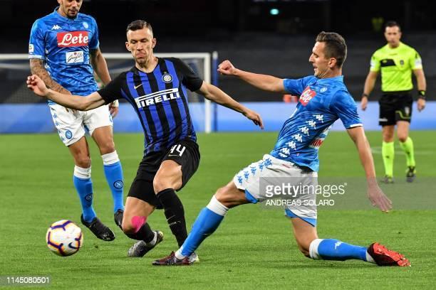 Inter's Croatian midfielder Ivan Perisic fights for the ball with Napoli's Polish forward Arkadiusz Milik during the Italian Serie A football match...