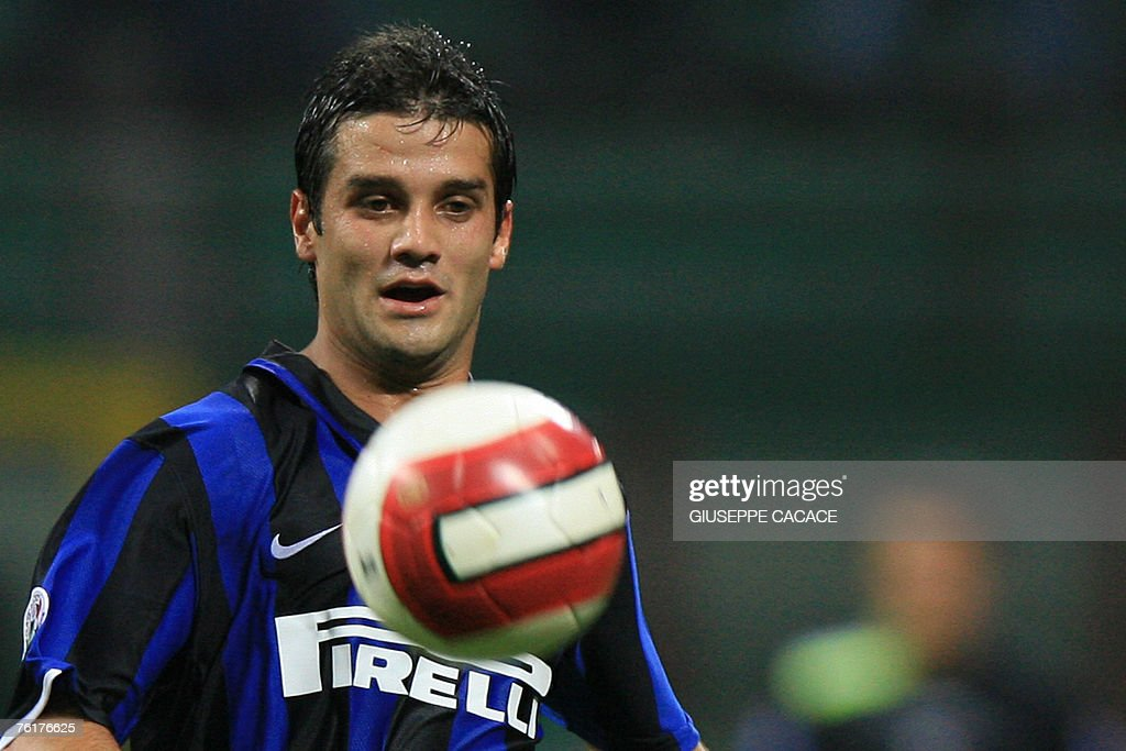 Inters defender cristian chivu of roman pictures getty images inters defender cristian chivu of romania eyes the ball during their tim super cup thecheapjerseys Image collections