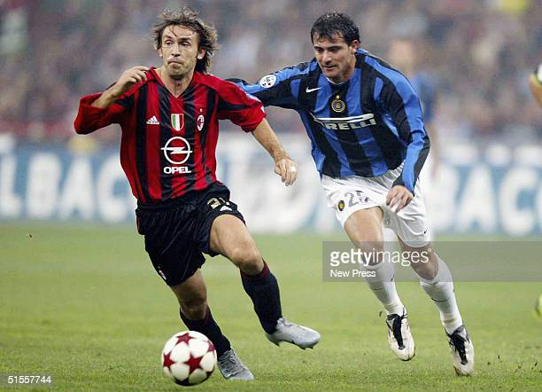 Inter's Dejan Stankovic goes after by AC Milan's Andrea Pirlo during the Italian Serie A match between AC Milan and Inter Milan at the Guiseppe...