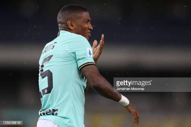Inter's English midfielder Ashley Young reacts after clashing with an opponent during the Serie A match between Hellas Verona and FC Internazionale...