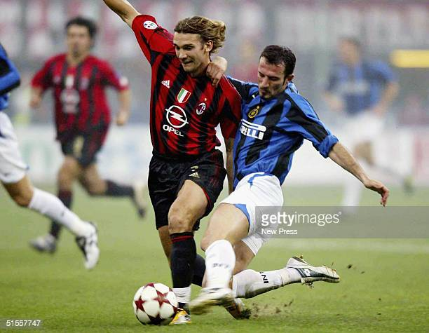 Inter's Guiseppe Favalli challenges AC Milan's Andrei Shevchenko during the Italian Serie A match between AC Milan and Inter Milan at the Guiseppe...