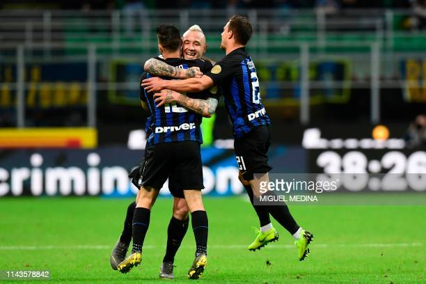 Inter's Italian forward Matteo Politano celebrates with teammates Belgium midfielder Radja Nainggolan and Portuguese defender Cedric Soares after...