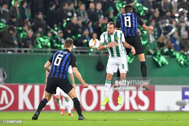 Inter's Matias Vecino and Rapid's Veton Berisha vie for the ball during the UEFA Europa League round of 32 firstleg football match between Rapid Wien...