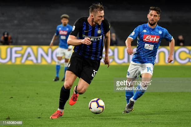 Inter's Slovakian defender Milan Skriniar fights for the ball with Napoli's Belgian forward Dries Mertens during the Italian Serie A football match...