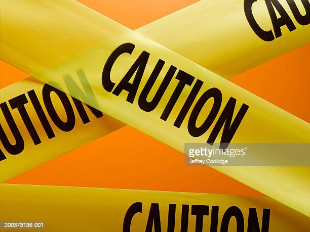 intersecting caution tape, close-up - cordon tape stock pictures, royalty-free photos & images