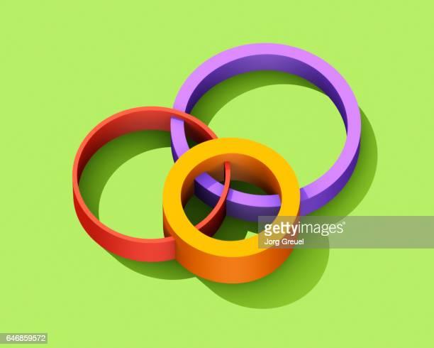 intersecting multicolored circles - drie dingen stockfoto's en -beelden
