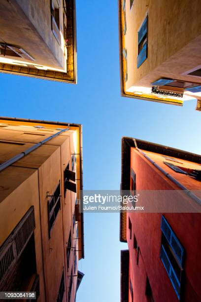 intersection of alleys in old nice, france - x art photos et images de collection