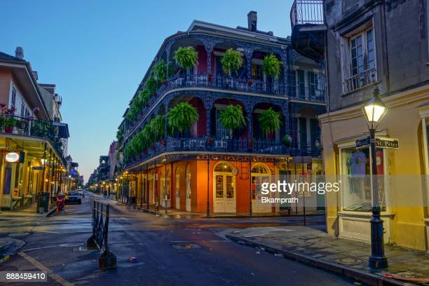 intersection of st. peter and royal streets in the french quarter of new orleans, louisiana - new orleans french quarter stock photos and pictures