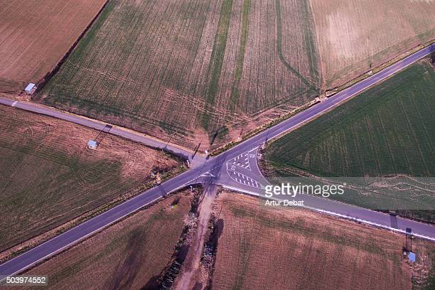 Intersection road from above with fields in the Catalan Pyrenees.