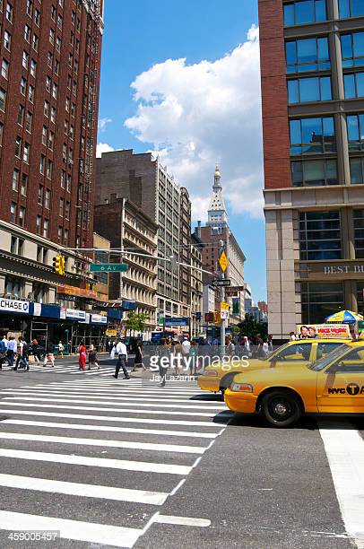 nyc intersections, pedestrians, taxis, 6th ave & w23rd street, manhattan - sixth avenue stock pictures, royalty-free photos & images