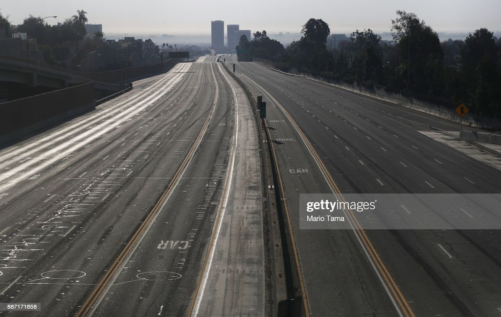 Interstate 405 is deserted after being closed during rush hour in an area near the Skirball Fire on December 6, 2017 in Los Angeles, California. Strong Santa Ana winds are rapidly pushing multiple wildfires across the region, expanding across tens of thousands of acres and destroying hundreds of homes and structures.