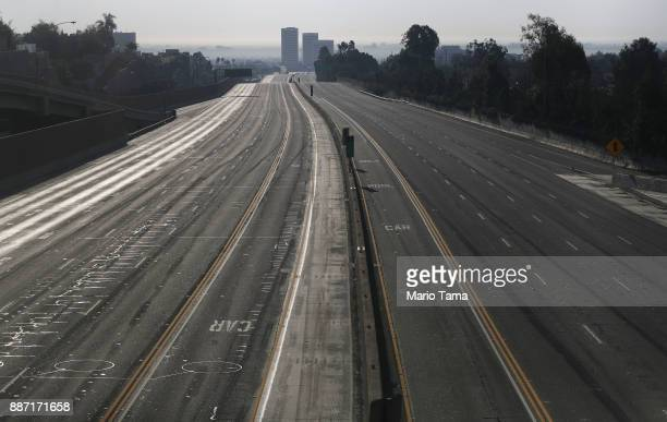 Interstate 405 is deserted after being closed during rush hour in an area near the Skirball Fire on December 6 2017 in Los Angeles California Strong...
