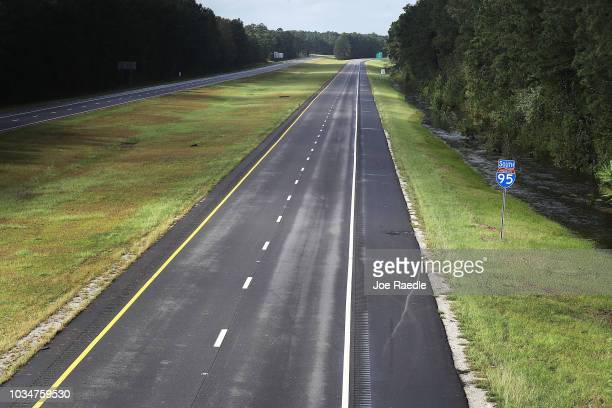 Interstate 95 is empty of traffic as authorities shut down parts of the highway due to flooding from rivers cresting from the rains caused by...