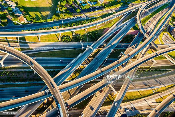 interstate highway interchange i10 i410 convoluted mixmaster san antonio aerial - san antonio texas stock photos and pictures