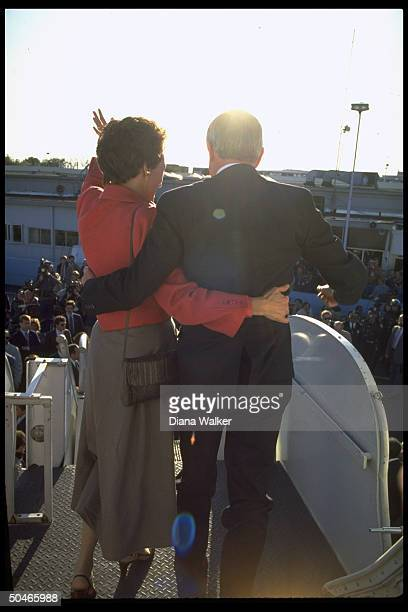 Intertwined armspoised Walter Joan Mondale turned waving to crowd bidding them farewell before bding plane heading home to MN after losing pres...
