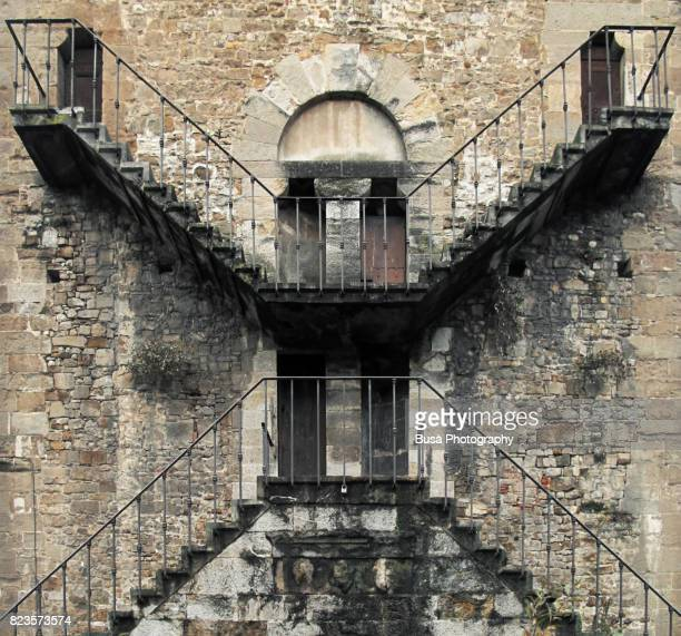 Intertwining stairs on the back of San Niccolò's fortified ancient city walls in Florence, Italy