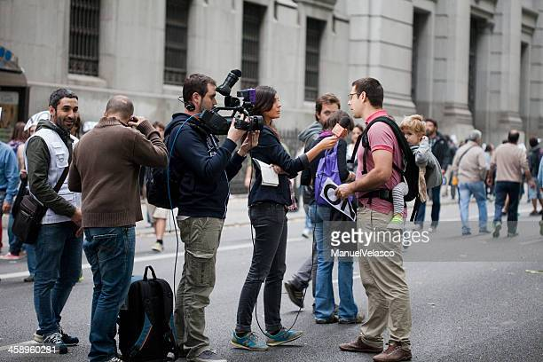 interview in the street - media interview stock pictures, royalty-free photos & images