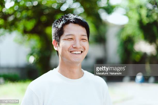 interview style portrait of a japanese man - national holiday stock pictures, royalty-free photos & images