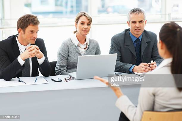 Interviewers in conversation with applicant