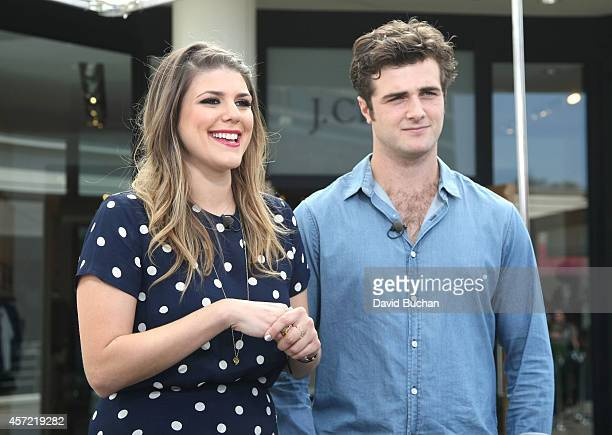 EXTRA interviews Beau Mirchoff and Molly Tarlov at Westfield Century City on October 14 2014 in Los Angeles California