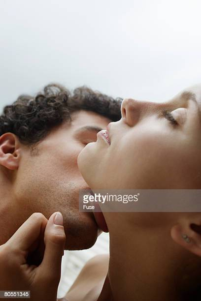 intimate couple making out - bacio sulla bocca foto e immagini stock