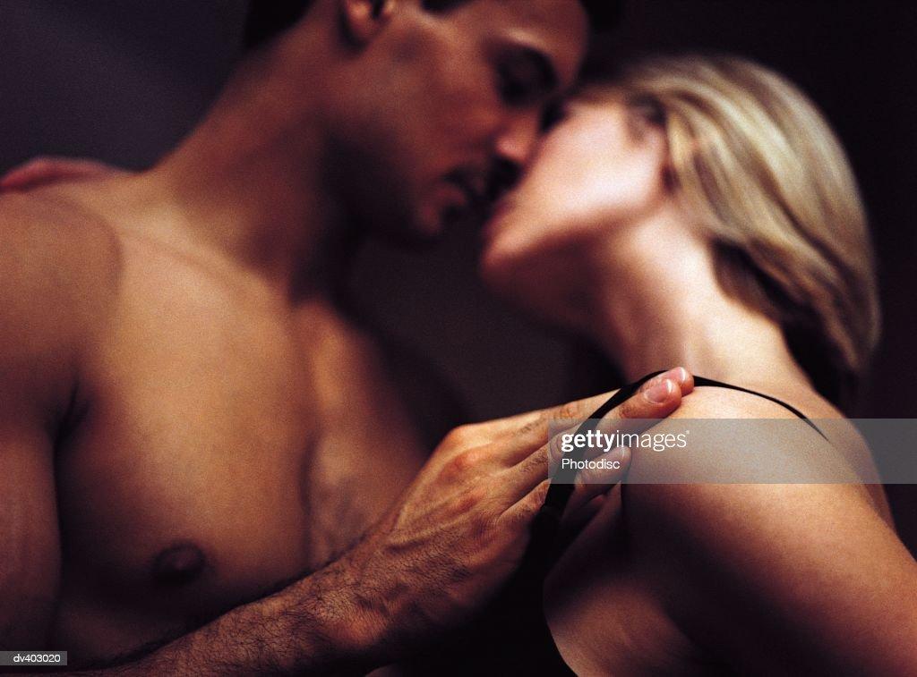 Intimate couple undressing : Stock Photo
