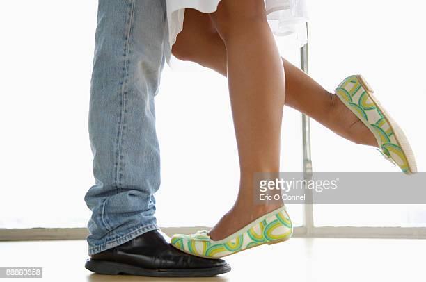 Intimate couple's legs