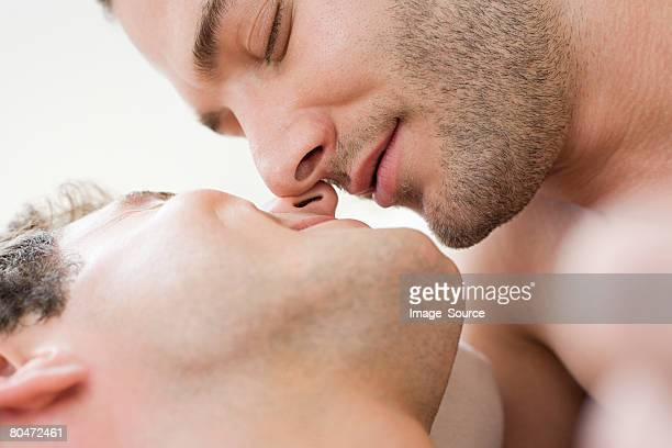 intimate gay couple - kissing stock pictures, royalty-free photos & images