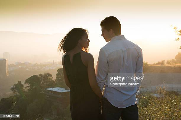 Intimate moment with couple on landscape
