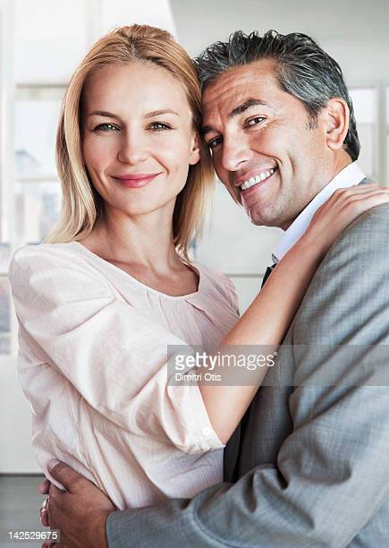 Intimate, romantic couple, smiling, close-up