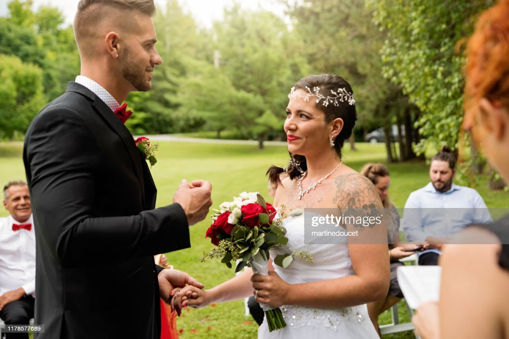 Intimate wedding ceremony for millennial couple. : Stock Photo
