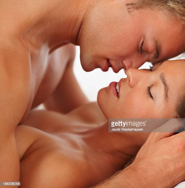 intimate young couple during foreplay - male female nude stock pictures, royalty-free photos & images