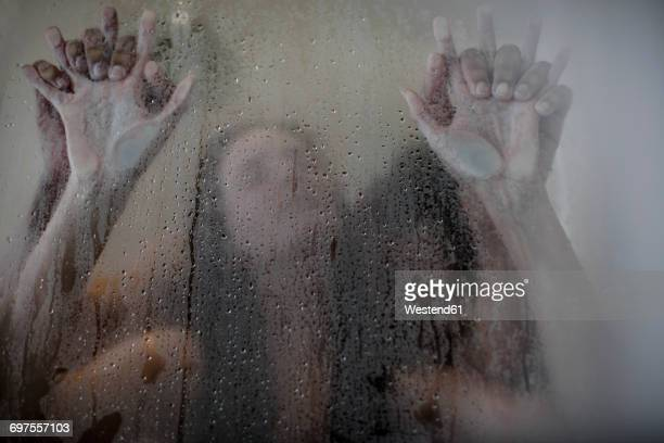 intimate young couple in shower - erotiek stockfoto's en -beelden