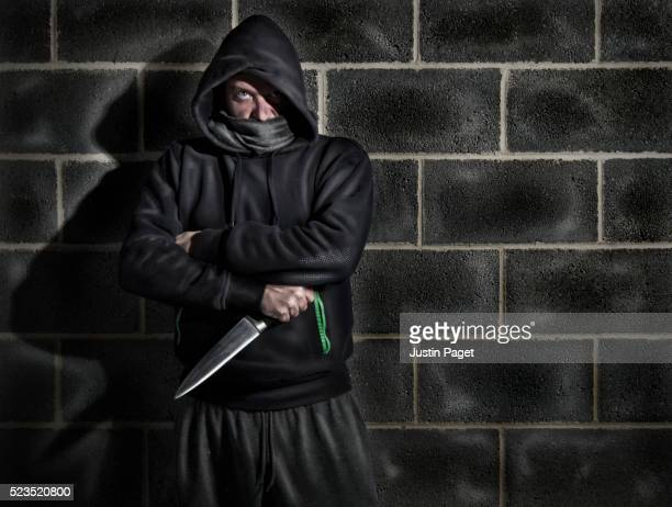 Intimidating Hooded Male Clutching Knife