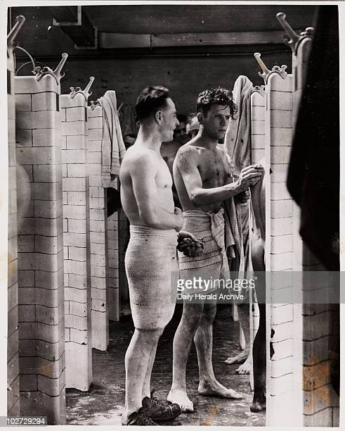 'Into Battle' 1947 A photograph of coal miners in the pithead baths taken by Hicklin for the Daily Herald newspaper in 1947 This photograph has been...
