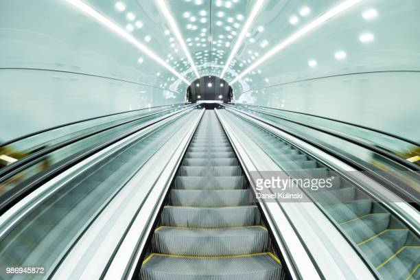 into the dark - escalator stock pictures, royalty-free photos & images