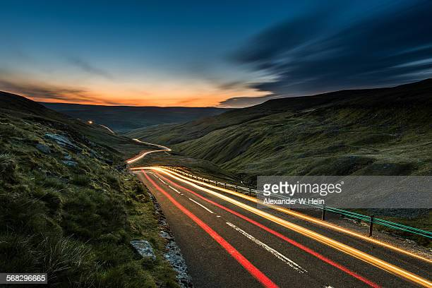 into the dawn - light trail stock photos and pictures