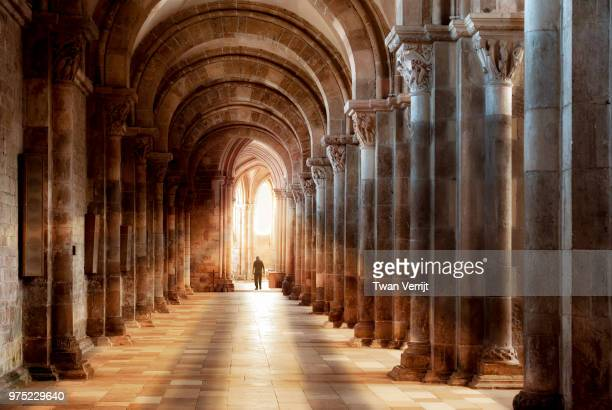 into the light - cloister stock pictures, royalty-free photos & images