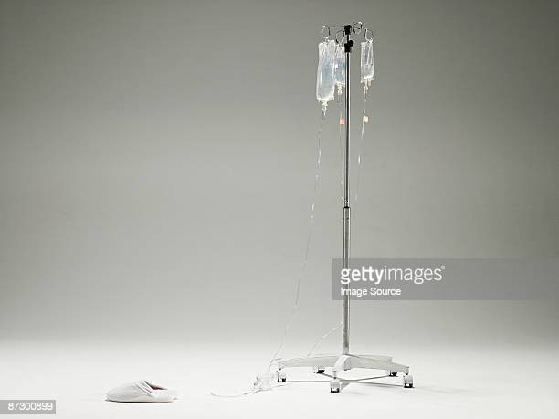 intravenous drip and slippers - iv drip stock pictures, royalty-free photos & images