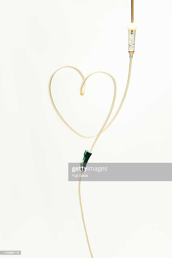 ?Intravenous feeding forming hart : Foto stock
