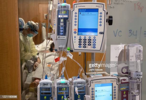 Intravenous therapy equipment hangs outside a COVID-19 patient's door in a Stamford Hospital Intensive Care Unit , on April 24, 2020 in Stamford,...