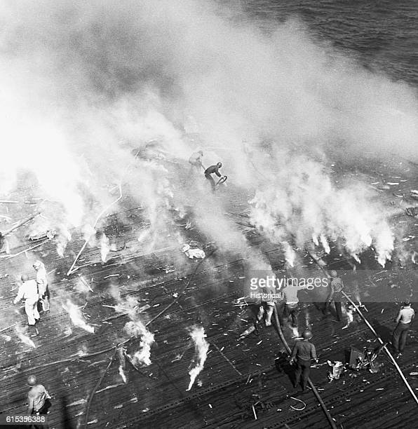 Intrepid firefighters battle the fires caused by a kamikaze strike during the battle for Leyte Gulf in the Philippines. November 25, 1944. |...