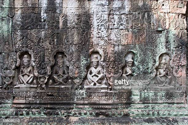 Intricate carvings at Preah Khan, which was built and used by Jayavarman VII. Living there while Angkor Thom was being reconstructed. Once having the...